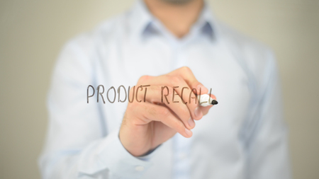 Product Recall, man writing on transparent screen Stock Photo