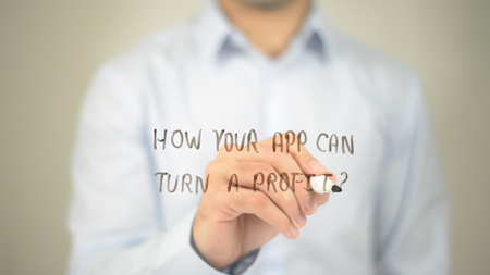 How Your App Can Turn A Profit ? , man writing on transparent screen