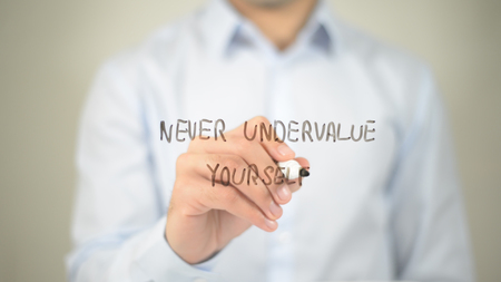 Never Undervalue Yourself , man writing on transparent screen
