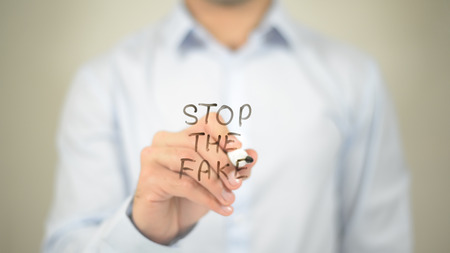 Stop The Fake   ,  man writing on transparent wall