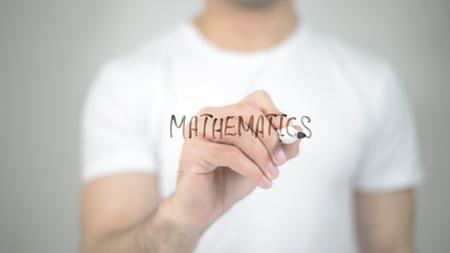 Mathematics, man writing on transparent screen