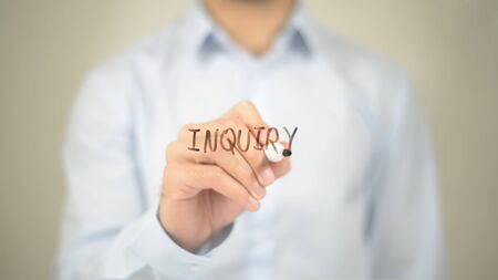 Inquiry , Man writing on transparent screen Stock Photo