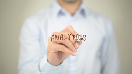 Analytics, man writing on transparent screen