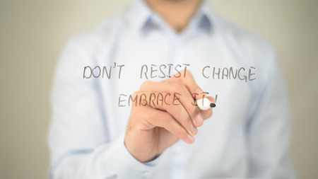 Dont Resist Change Embrace It , man writing on transparent screen Stock Photo