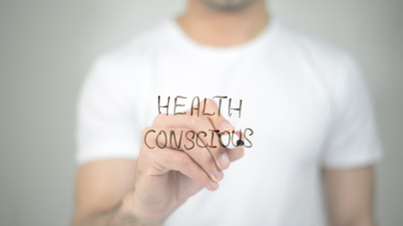 Health Consious, man writing on transparent screen Stock Photo