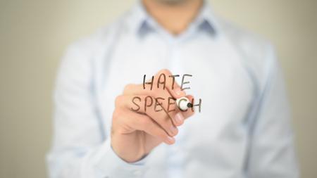 Hate Speech , man writing on transparent screen