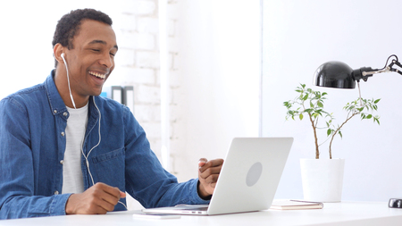 Video Chat by Handsome  Afro-American Man Stock Photo