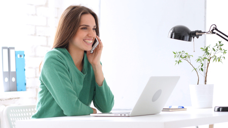 Creative Woman Talking on Phone at Work, Sharing Information
