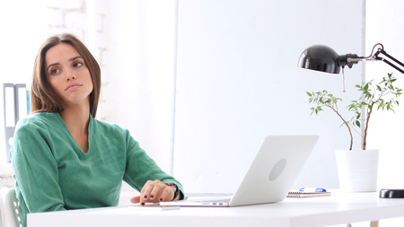 Woman Waiting in Office