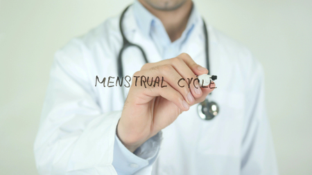 Menstrual Cycle, Doctor Writing on Transparent Screen