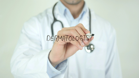 gestational: Dermatologist, Doctor Writing on Transparent Screen Stock Photo