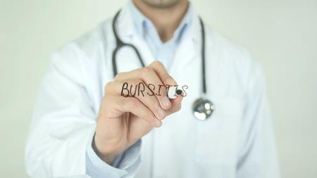 Bursitis, Doctor Writing on Transparent Screen Stock Photo