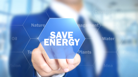 Save Energy, Man Working on Holographic Interface, Visual Screen Stock Photo