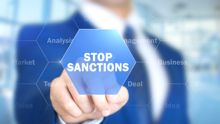 Stop Sanctions, Man Working on Holographic Interface, Visual Screen Stock Photo