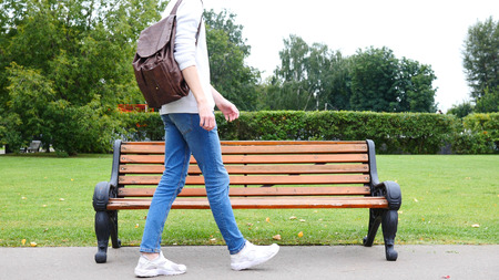 cerrando negocio: Man Walking in Park,  Coming to Sit on Bench, Red Hairs