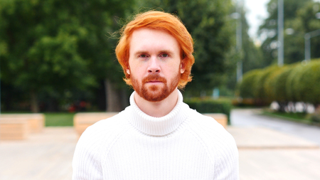 Portrait of Serious Man with Red Hairs, Outdoor