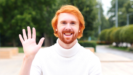 Wavng Hand, Man Talking to Camera, Online Video Chat, Outdoor Stock Photo