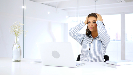 Reaction on  Business Loss on Laptop by Woman at Work