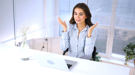 Reaction on Business Loss on Laptop by Woman at Work Stock Photo