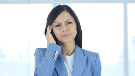 Headache, Upset Tense Young Female in Office