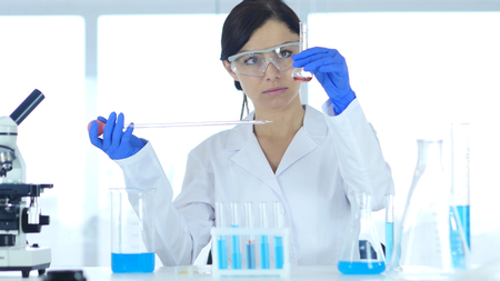 Woman Scientist Busy Doing Research and Reaction in Laboratory Фото со стока - 88750249
