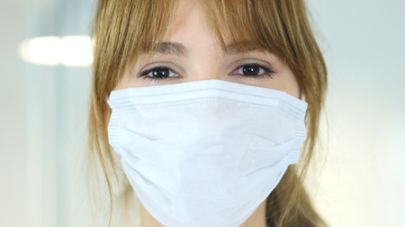 Close Up of Female Reseach Scientist, Doctor in Mask Stock Photo
