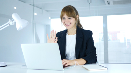 Busy Online Video Chat on Laptop at Work by Young Female
