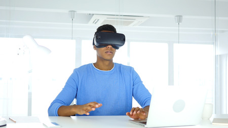 Wearing virtual reality glasses in Office, using with Smartphone VR goggles headset Stok Fotoğraf