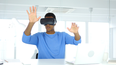 Afro-American Man wearing virtual reality glasses in Office, VR Goggles headset Stok Fotoğraf