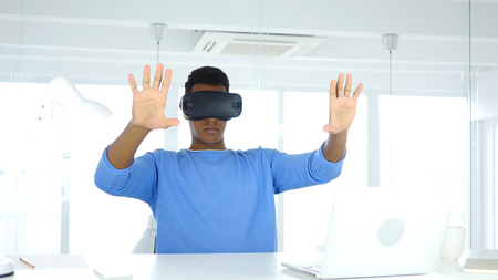 Man Working in Imagination, Wearing virtual reality glasses, VR Goggles headset