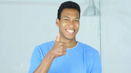 Thumbs Up by Happy Young Afro-American Man