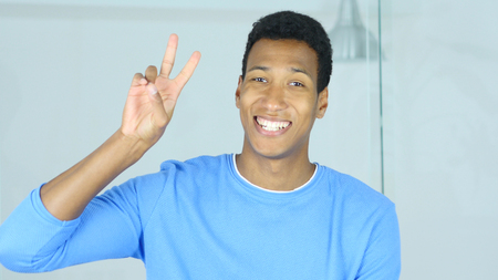 Victory Sign by Successful Young Afro-American Man Standard-Bild - 88961367