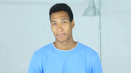 Portrait of Positive Afro-American Man Looking in Camera Imagens