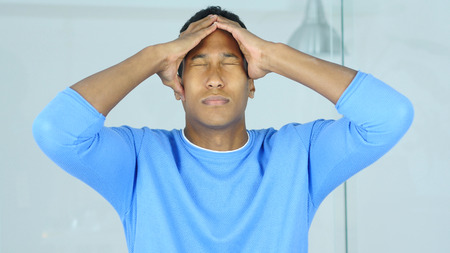 Headache, Pain in Head of Upset Tense Young Afro-American Man