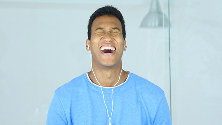 Laughing Handsome Afro-American Man with Headphone in Ears