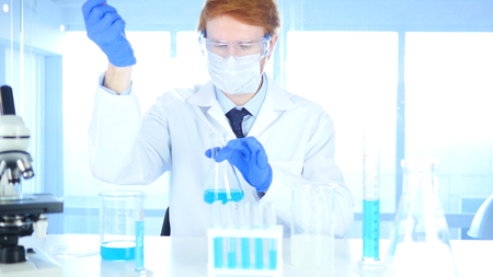 Scientist Busy Doing Research and Reaction in Laboratory