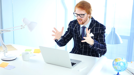 Redhead Businessman Upset by Loss while Working on Laptop, Creative Designer