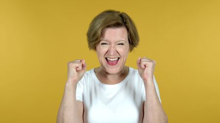 Yes, Old Woman Shaking Head to Accept Isolated on Yellow Background