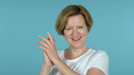 Clapping Old Woman Applauding Isolated on Blue Background
