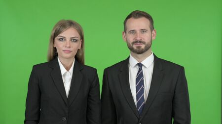 The Smiling Business People Toward Camera Against Chroma Key