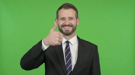 The Young Businessman Showing Thumbs Up against Chroma Key Zdjęcie Seryjne