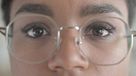The Close-up Shot of Young African Girl wearing glasses Zdjęcie Seryjne