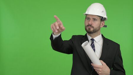 The Young Engineer pointing with Finger and Yes sign against Chroma Key Banco de Imagens