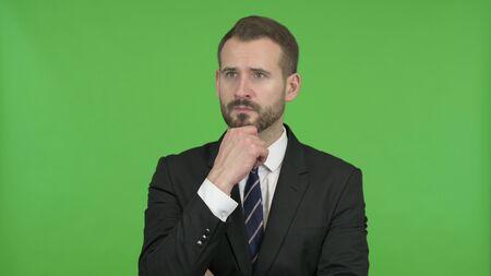 The Ambitious Businessman Thinking of Something against Chroma Key