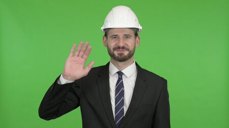 The Ambitious Engineer Waving Hand Sign and Talking against Chroma Key