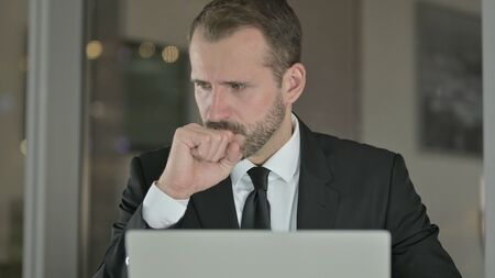 The Close Up of Sick Businessman Coughing while working at Night Stock fotó