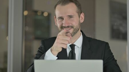 The Close Up of Mature Businessman Pointing Finger to Camera at Night Stock fotó