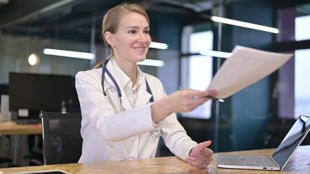 Young Female Doctor Giving Documents, Medical Report