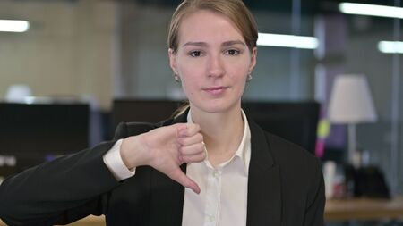 Portrait of Young Businesswoman doing Thumbs Down Stock fotó