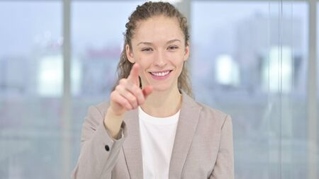 Portrait of Beautiful Young Businesswoman Pointing at Camera Stock Photo